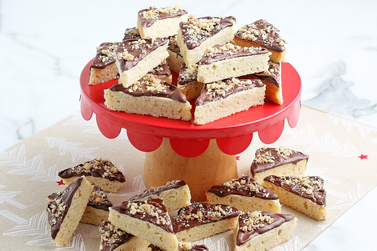 red plate of frosted cookie bars