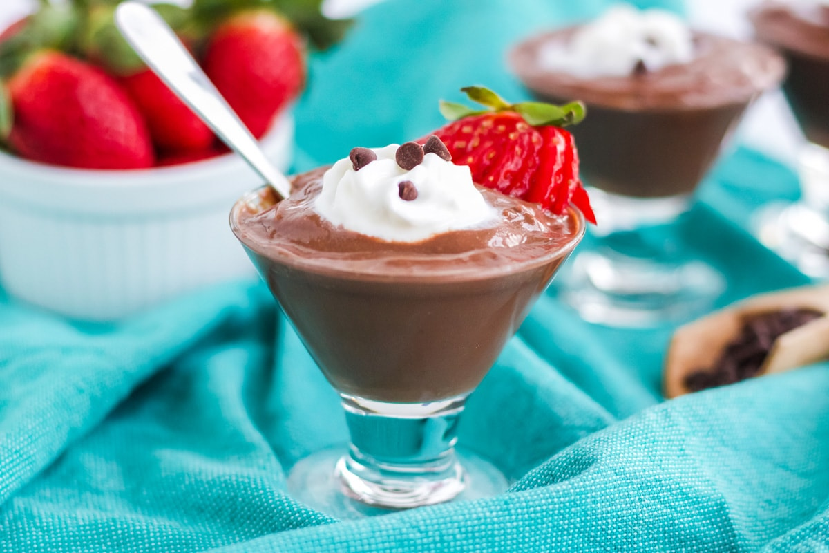 garnished chocolate pudding with teal linen