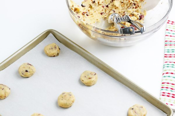 cookies scooped out onto a baking sheet