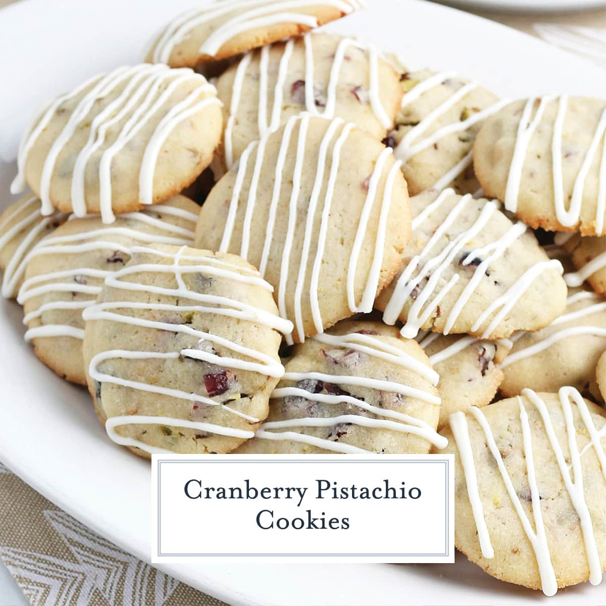 cranberry pistachio cookies on a white serving platter