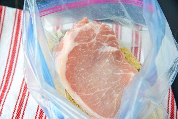 pork chop in a breadcrumb mixture