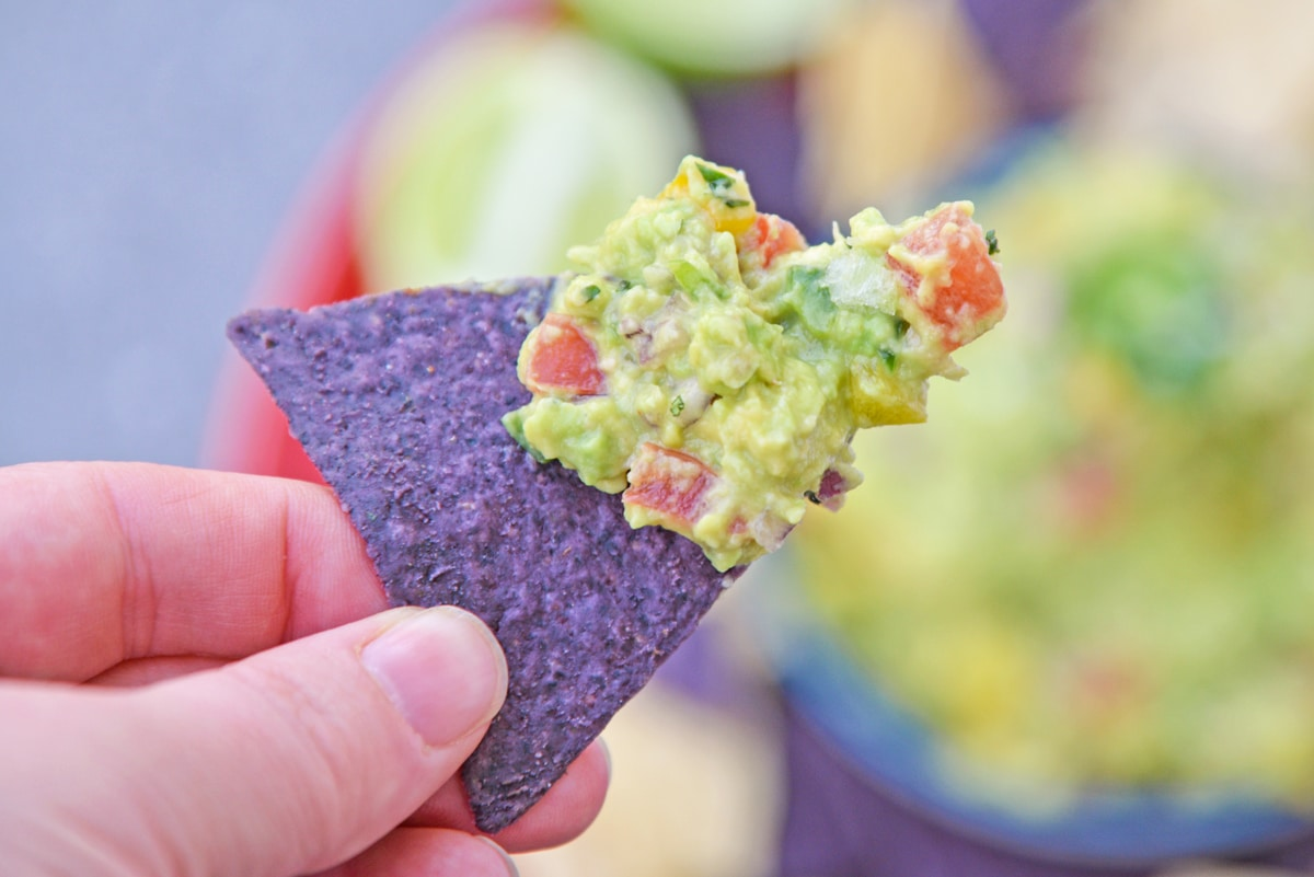 easy guacamole on a tortilla chip