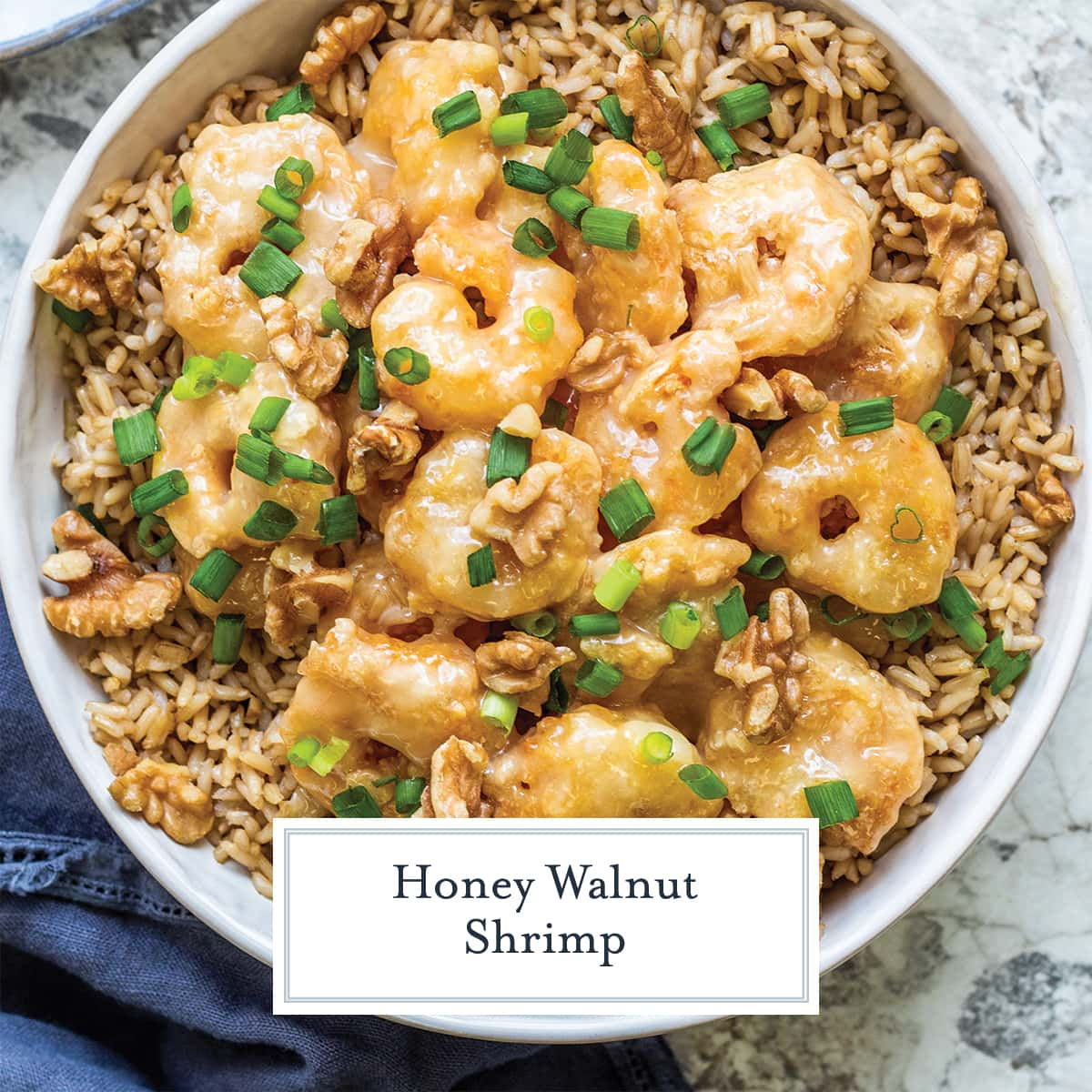 overhead of honey walnut shrimp over brown rice with scallions