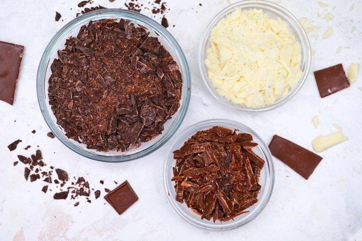 three bowls of chopped chocolate