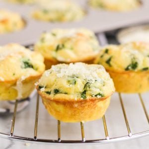 close up of quiche florentine muffins on a cooling rack