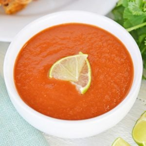close up of ranchero sauce with limes