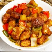 white plate of sweet and sour chicken