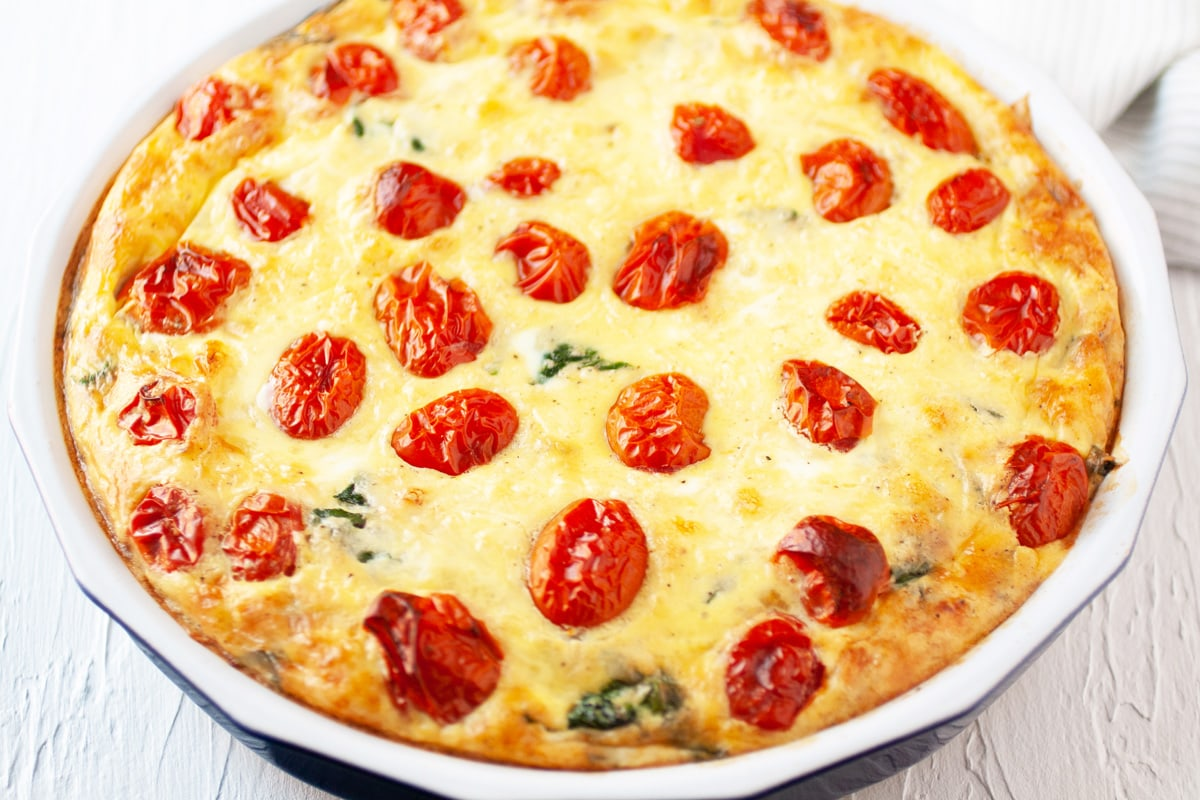 angle of quiche with tomato topping