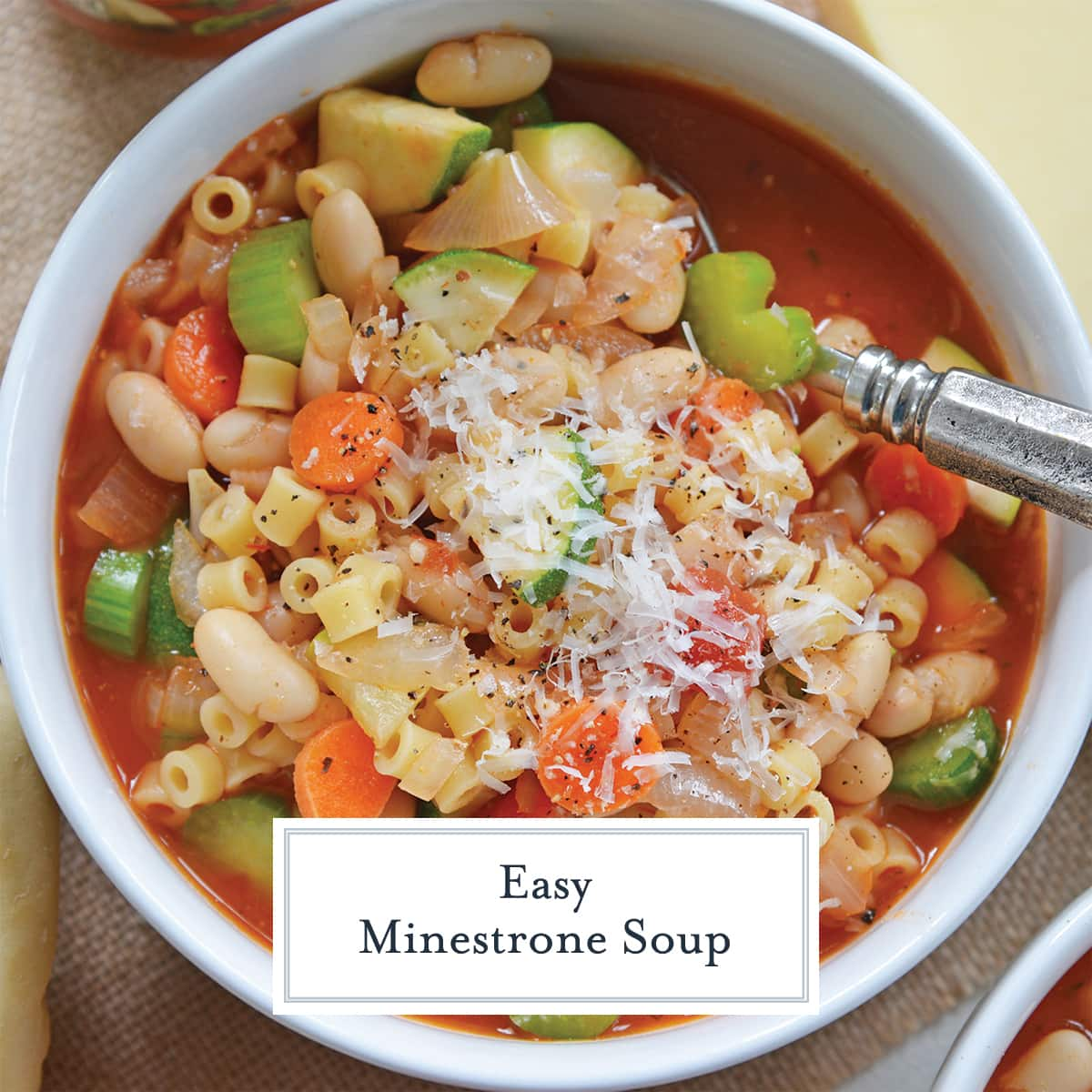 overhead of minestrone soup in a white bowl