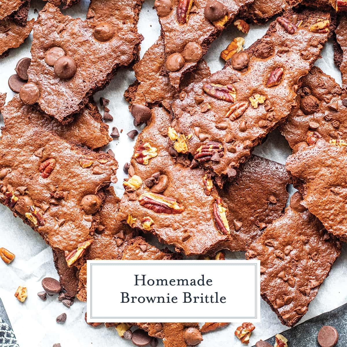 broken brownie brittle on white parchment
