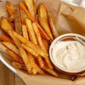 basket of cajun fries with sauce