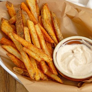 basket of cajun fries with sauce