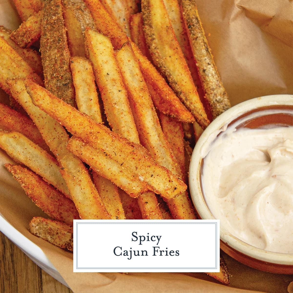 close up of seasoned Cajun fries with dipping sauce