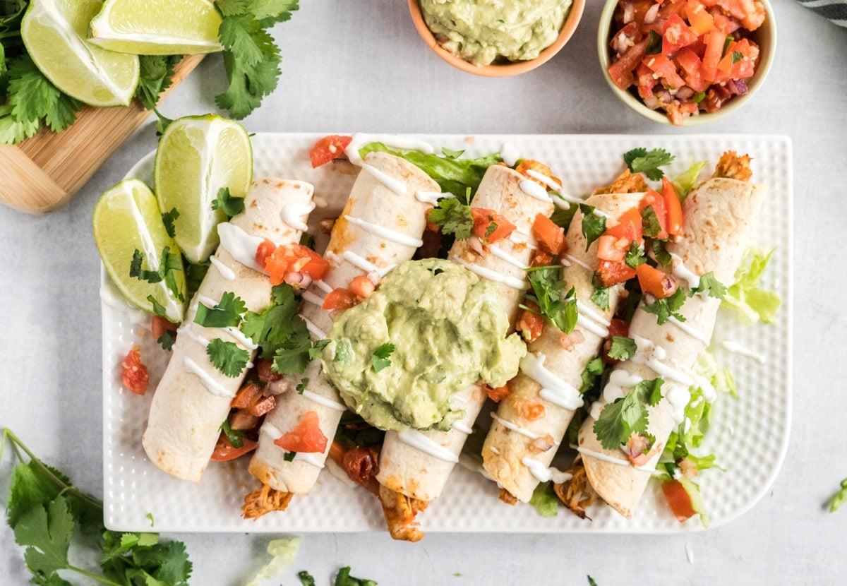 chicken taquitos on a serving platter