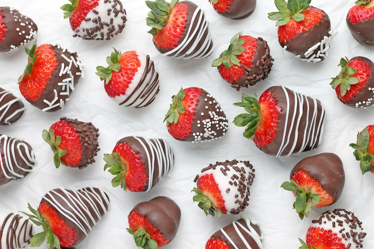 chocolate covered strawberries on parchment