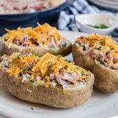 creamed chipped beef stuffed potatoes on a plate