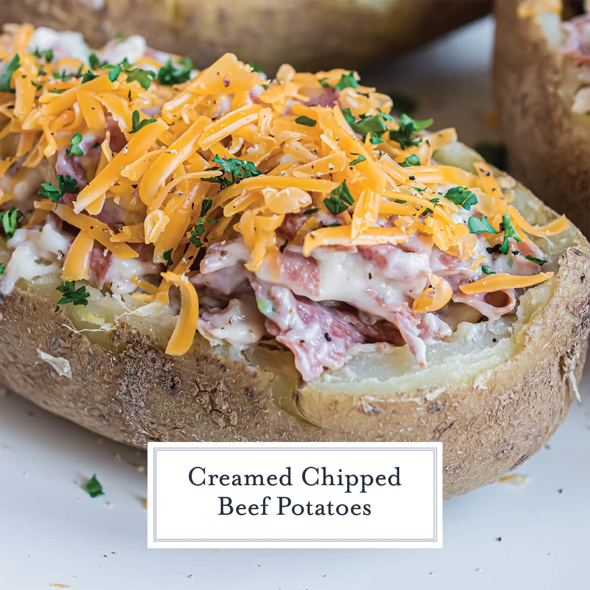 close up of creamed chipped beef potato topped with shredded cheese