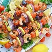 platter of garlic shrimp kabobs