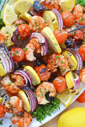 platter of garlic shrimp kabobs