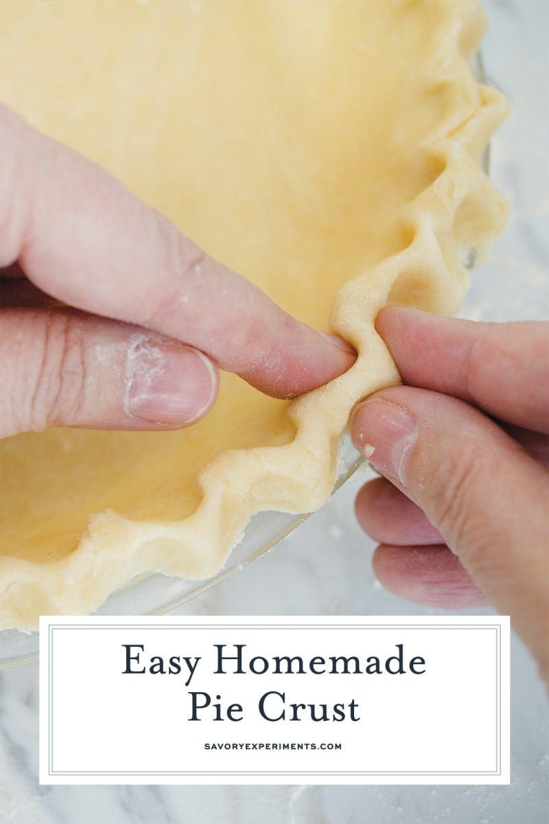 hand piercing together pie crust