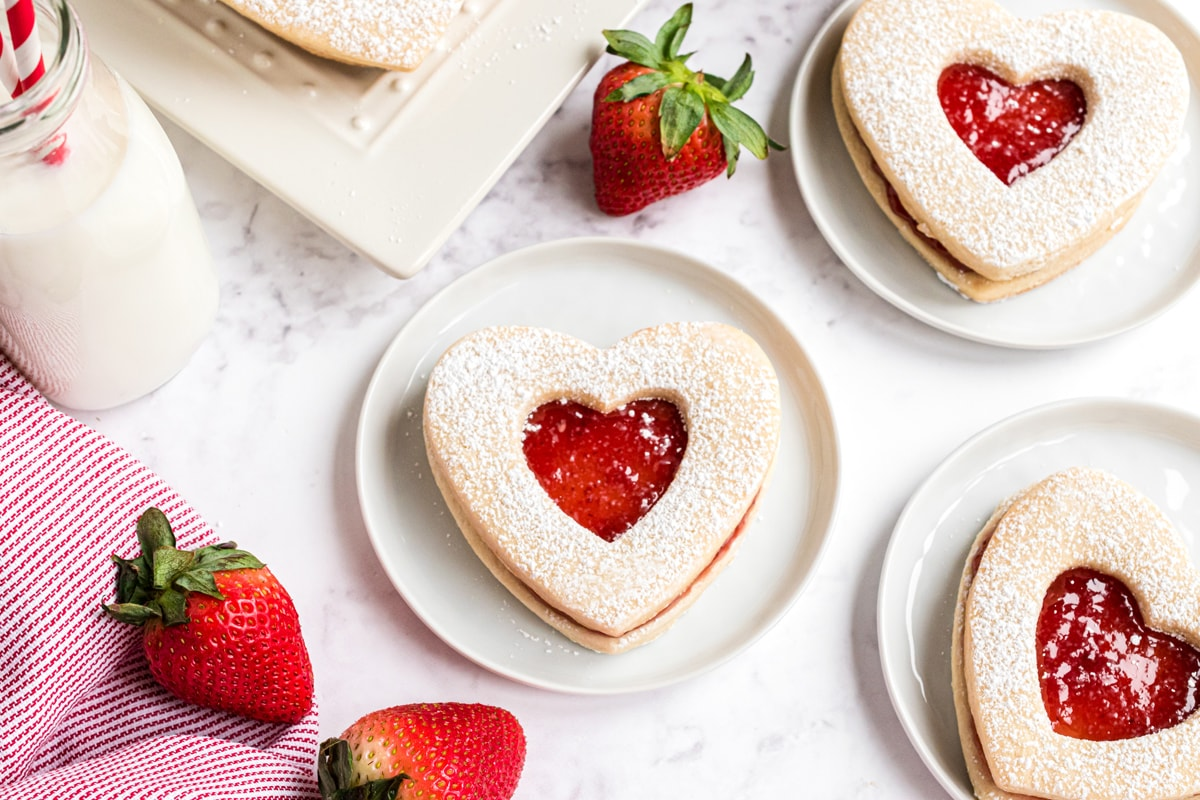 strawberry jam cookie on small what plates with fresh strawberries