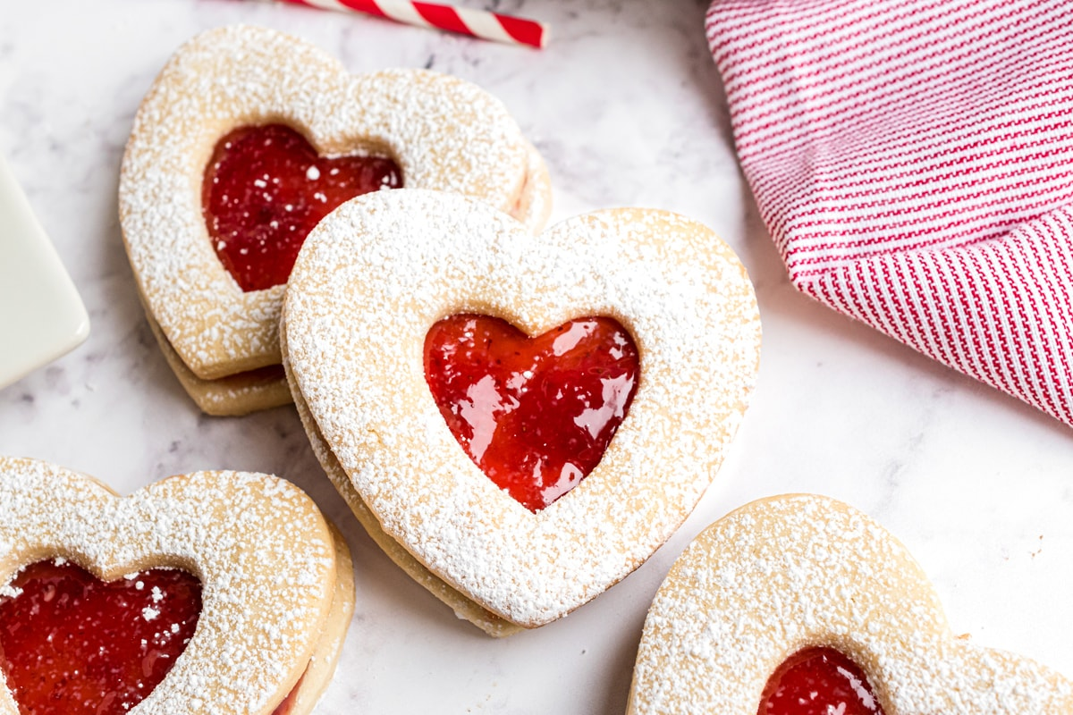 stacked jammie dodger cookies with red and white linen