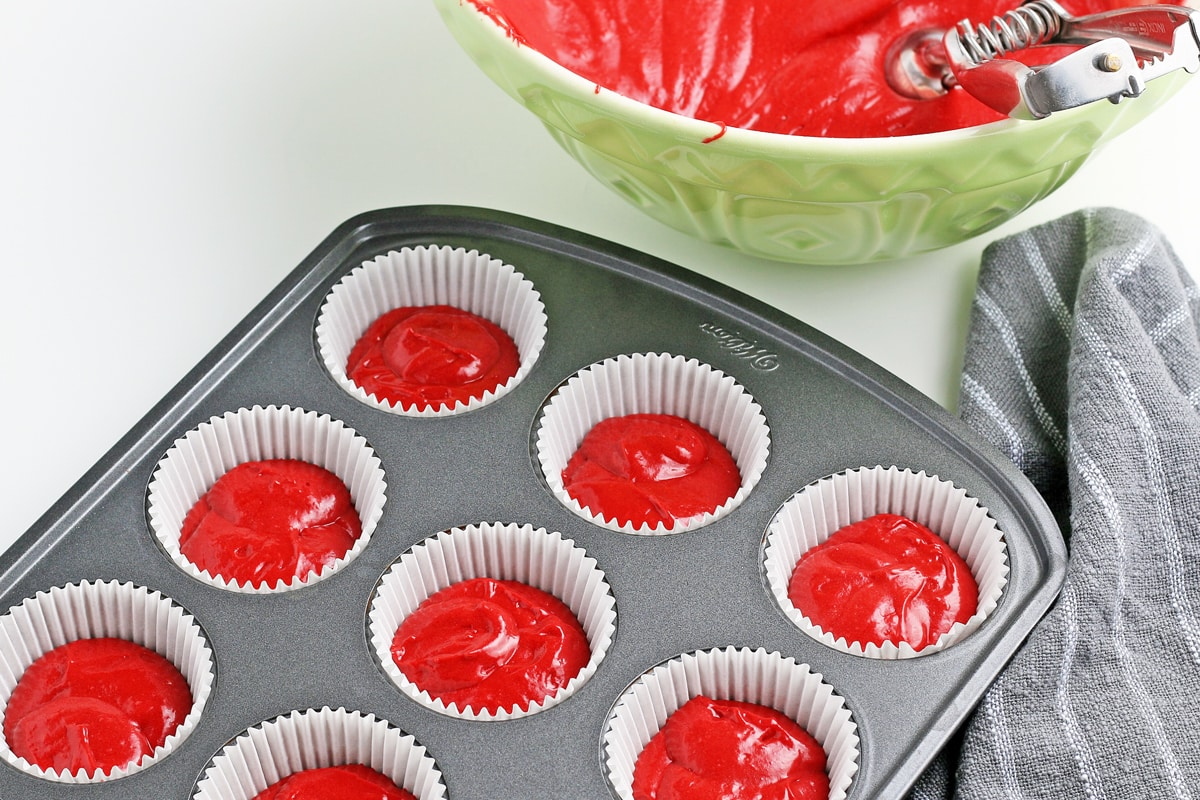 red velvet batter in a muffin tin