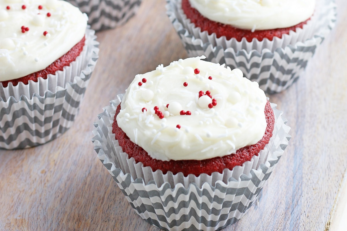 red velvet cupcakes on a wood background