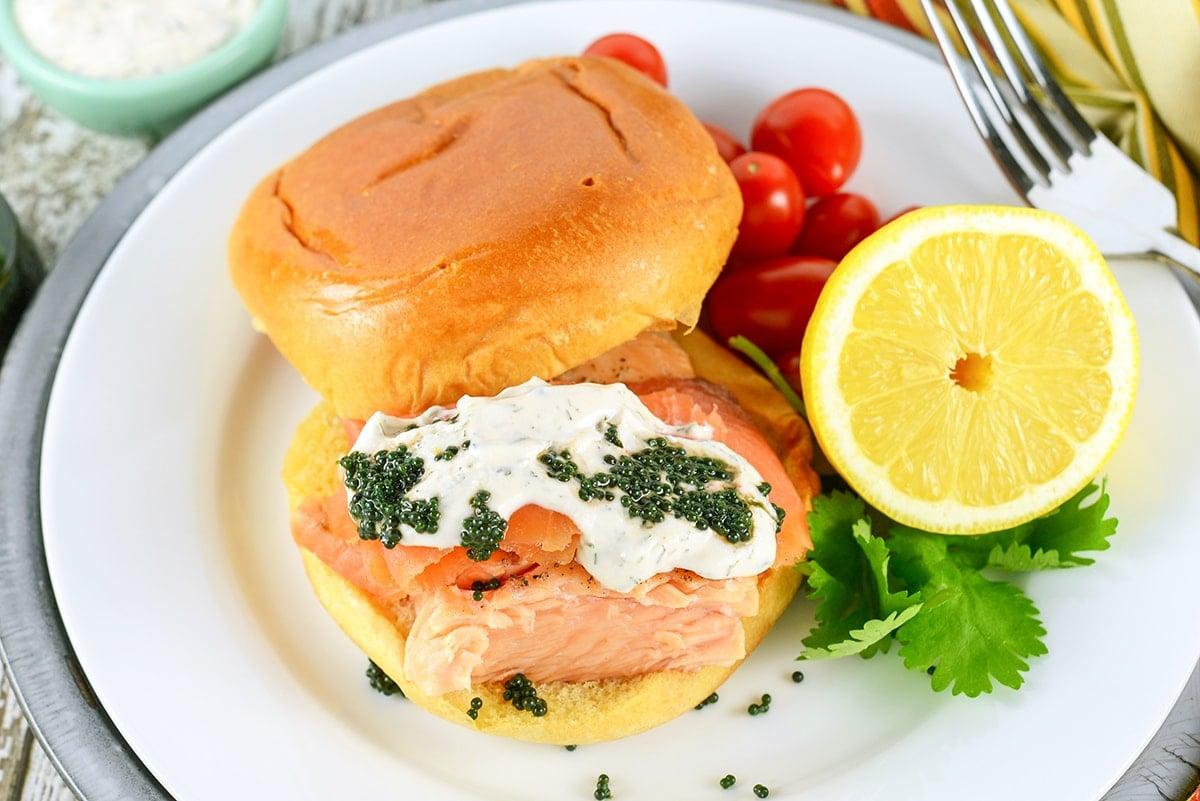overhead of salmon sandwich with caviar and cream