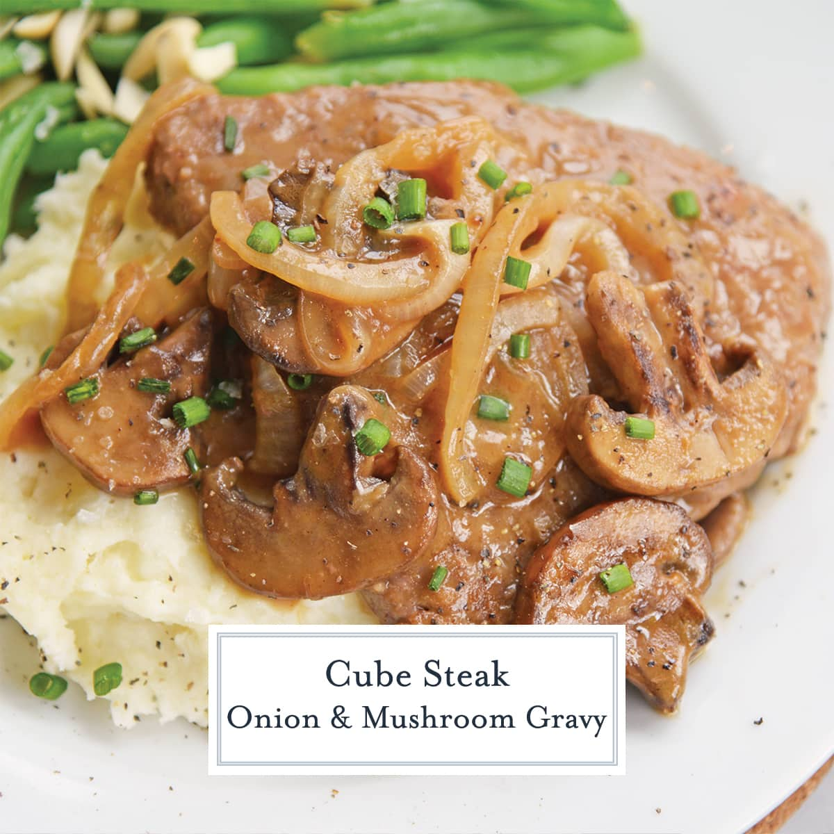 close up of cube steak with onion and mushroom gravy
