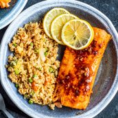 air fryer salmon on a plate with fried rice