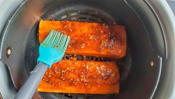 salmon in an air fryer basket