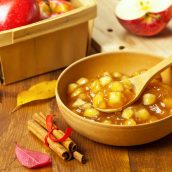 bowl of apple pie filling with cinnamon sticks