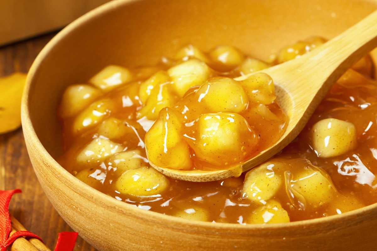 close up spoon of apple pie filling