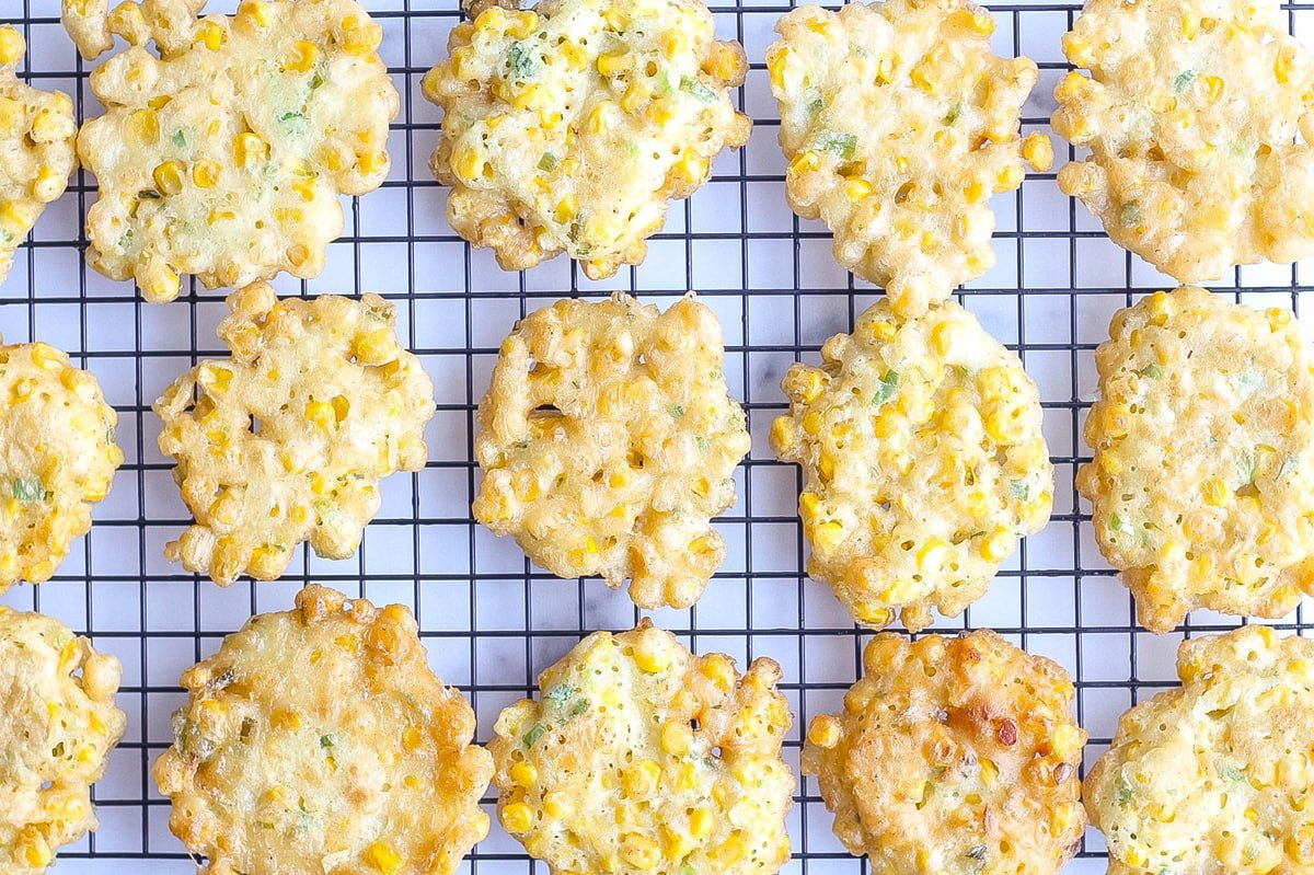 corn fritters on a wire rack draining