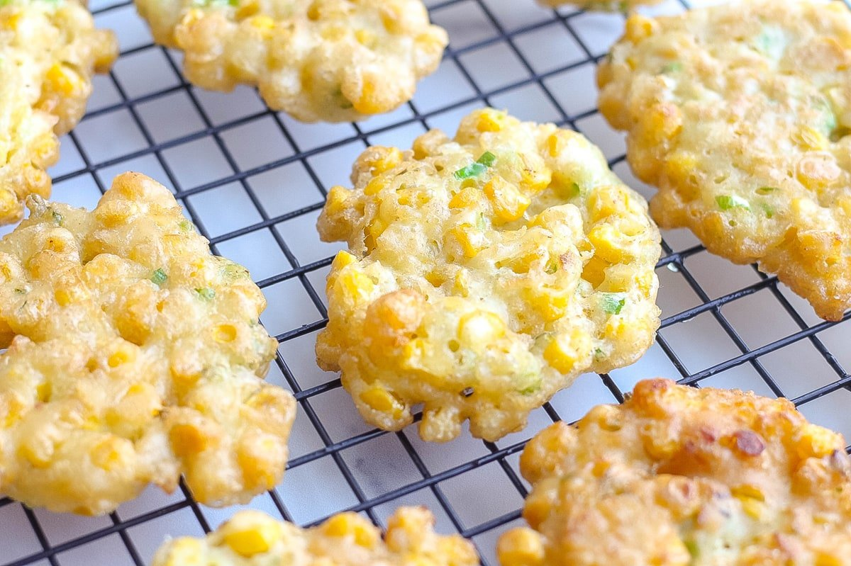 corn fritter cooling on a wire rack