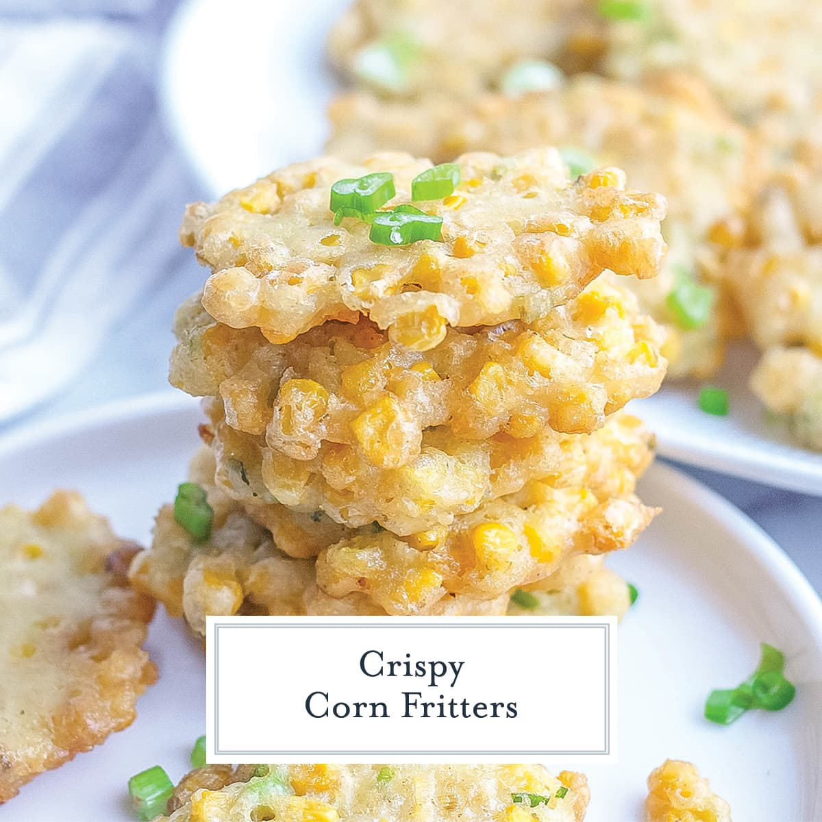 stack of fried corn fritters with scallions