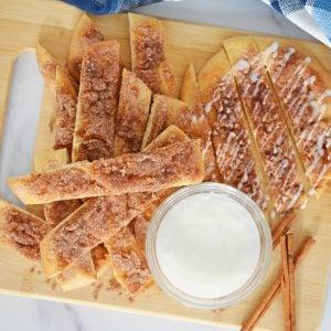 serving platter of cinna sticks with dipping sauce