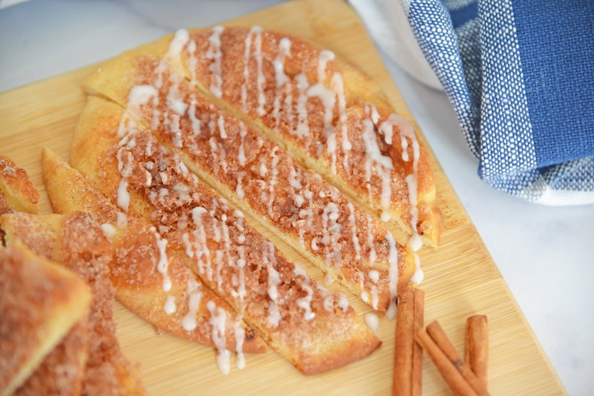 Sliced flatbread with cinnamon sugar and icing drizzle