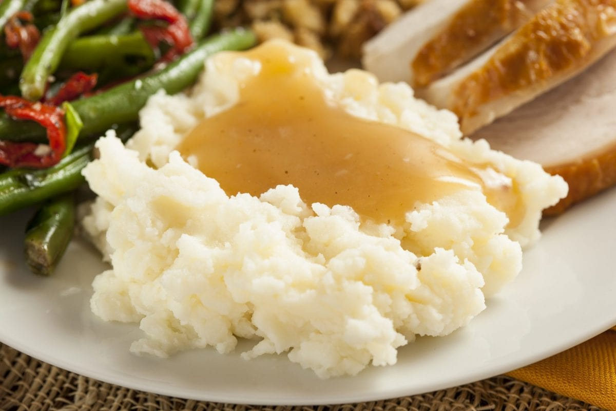 gravy from drippings over mashed potatoes