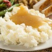 homemade gravy over mashed potatoes