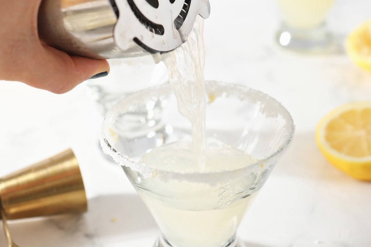 pouring martinis into a glass