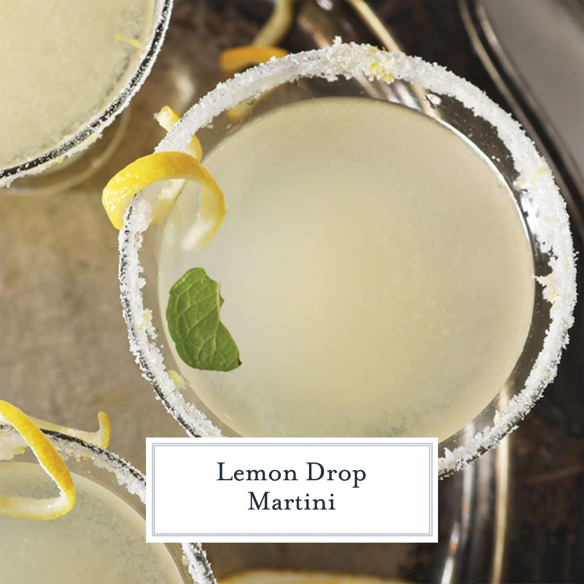 overhead close up of rimmed lemon drop martini with lemon twist