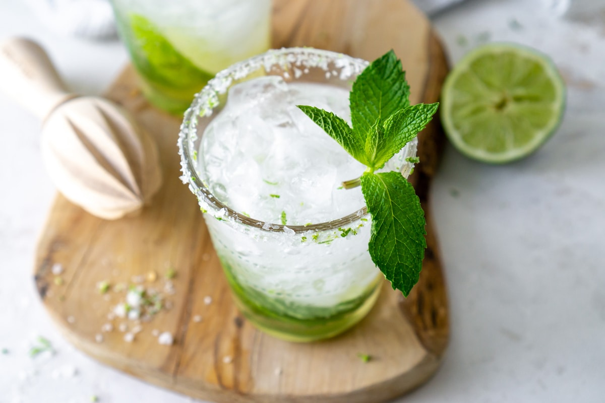 Angle of homemade mojito on wood cutting board