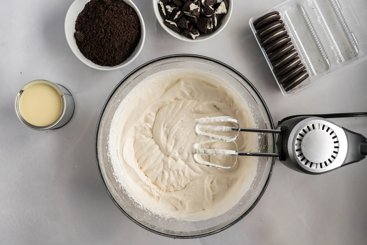 blending heavy whipping cream in a bowl