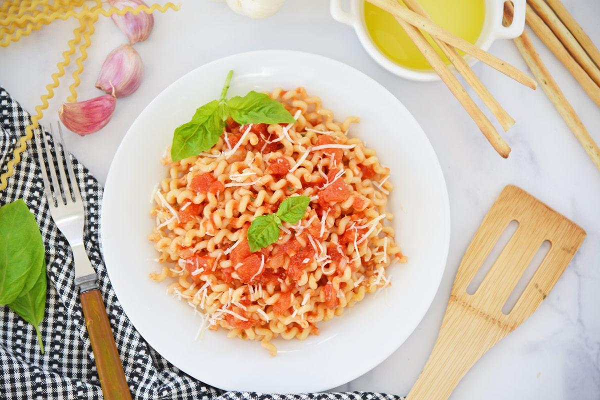 overhead of homemade pomodoro sauce over pasta