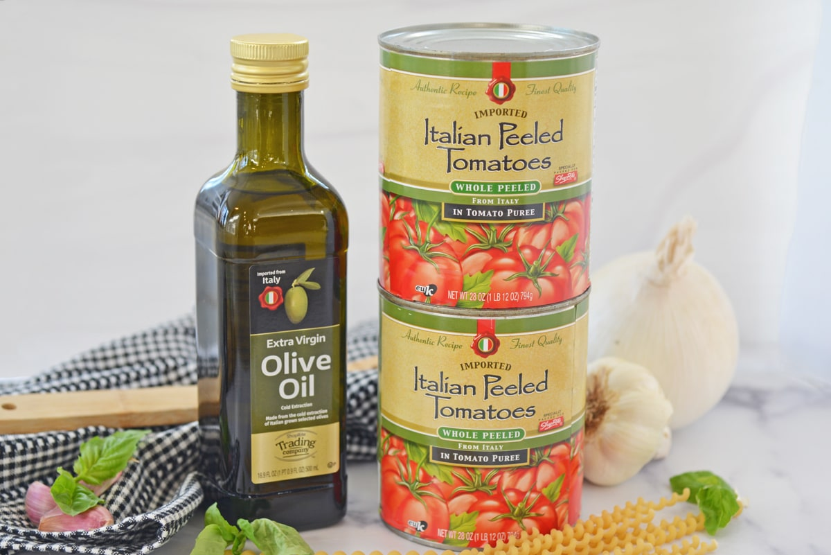 front image of canned tomatoes and olive oil