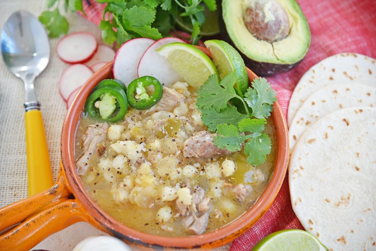 pozole with jalapeno, cilantro, lime and radish