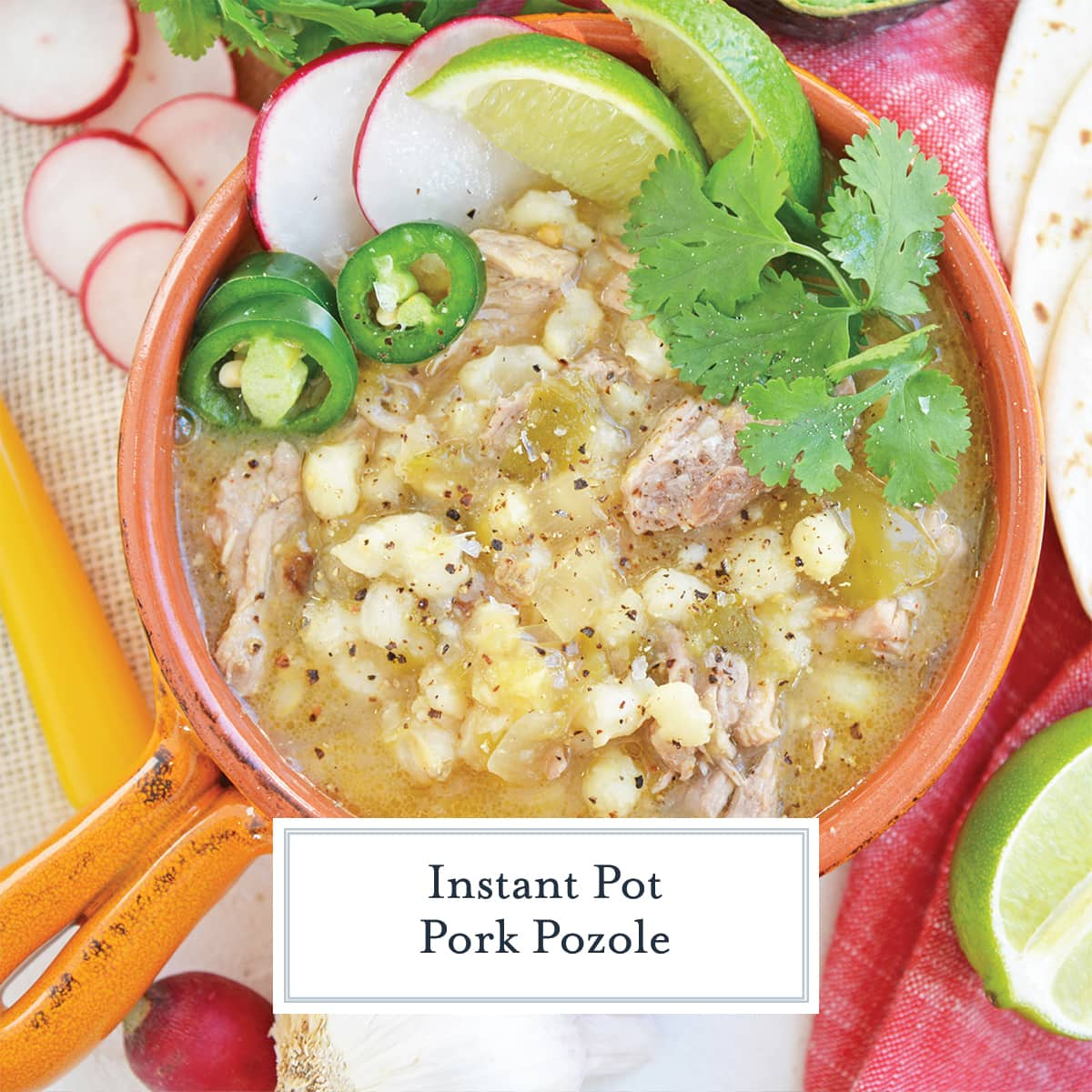 garnished pork pozole in orange bowl