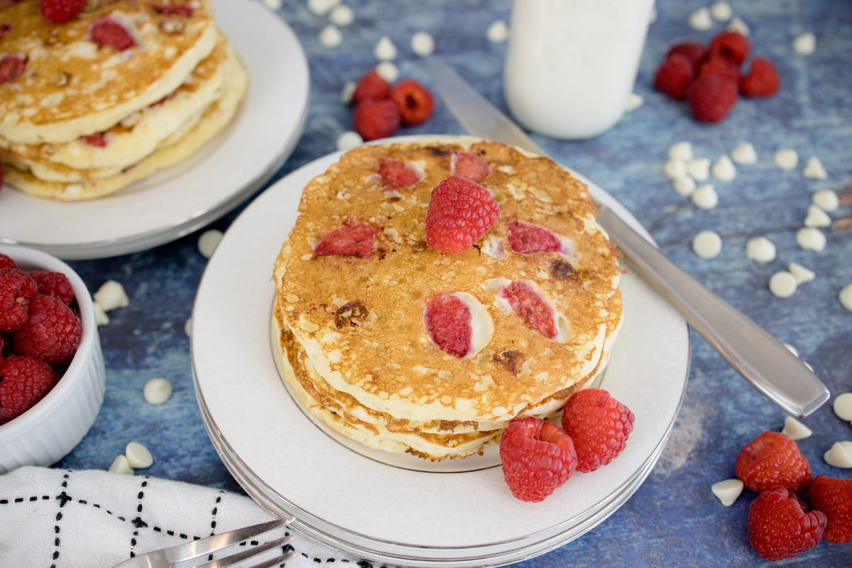 stack of raspberry pancakes without syrup